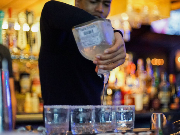 Bartender pouring shots from Patron Bottle