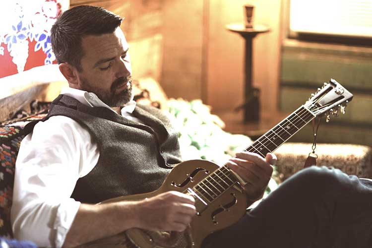 an image of martin harley playing a slide guitar