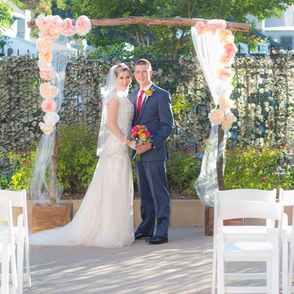 Couple under oak tree arch