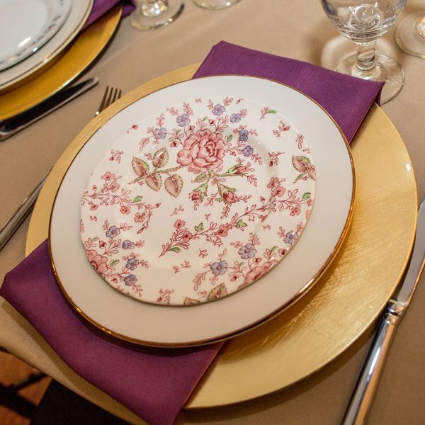 Mixed vintage china with gold charger