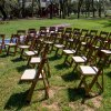 Fruitwood padded folding chairs in use at event