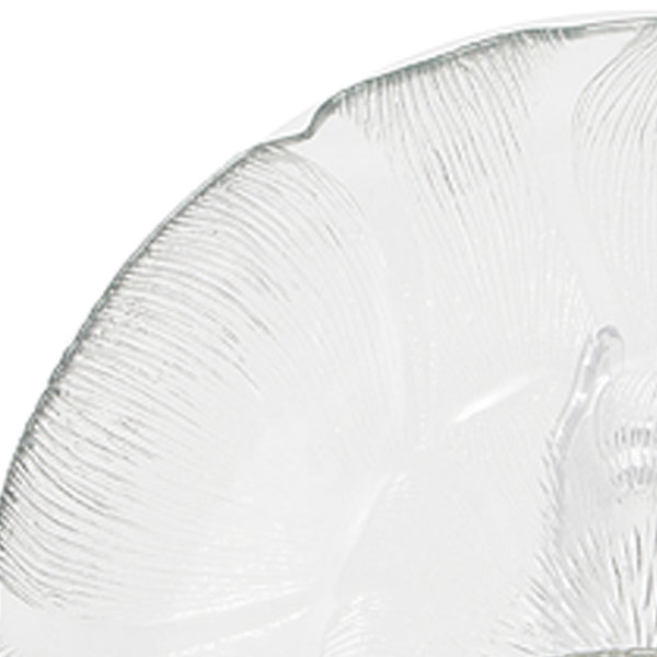 Closeup of etched design in the glass Magnolia plates