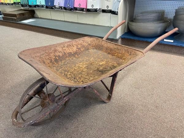 photo of rustic wheel barrow