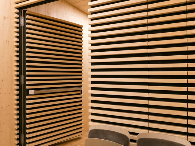 Narrow wooden slats that are mounted on the wall.
