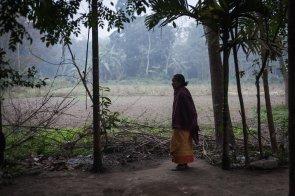 A Bodo woman outside her house in Tulshibil, Kokrajhar, Assam.
