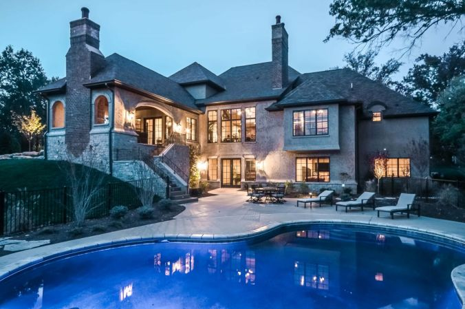 Custom home design with covered outdoor living space and pool