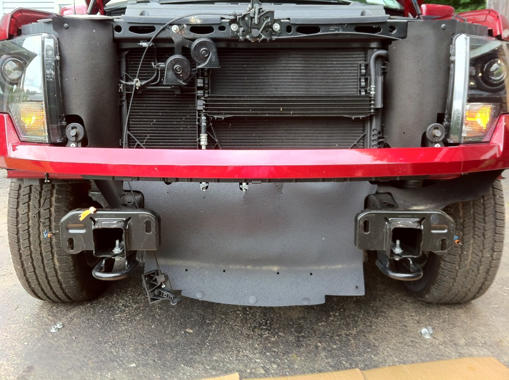 medium resolution of the air dam bolts onto a pair of studs threaded into spring clip nuts the tow bar brackets are larger than the tow hooks and the rear bracket bolt uses