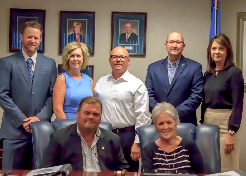 (back row, l-r): Secretary Ryan Franklin, Kim Hyden, Ray McQuiston, Bryan Cain and Paige Sherry; (seated, l-r): Vice Chair Curtis Morgan and Chair Marci Donaho