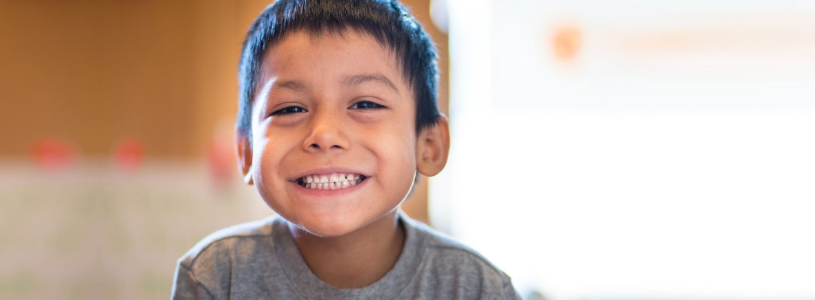 Young boy with giant smile