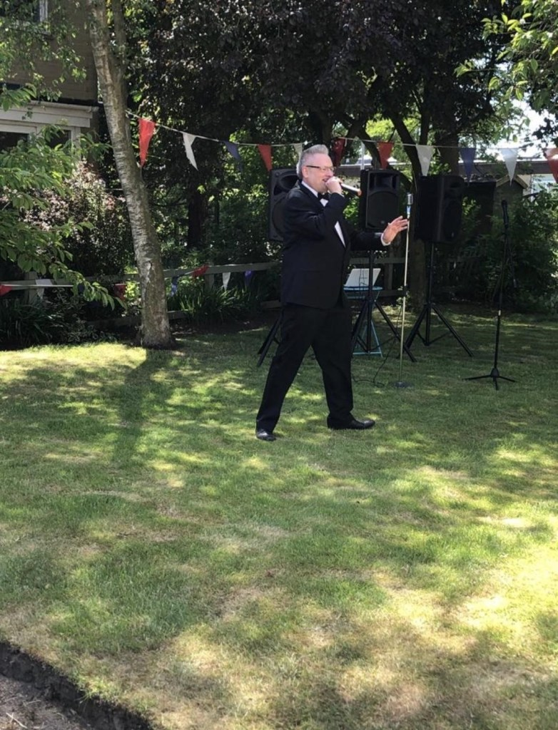 Martyn Crofts entertaining residents from a safe distance at the Neville House. Feedback for Martyn included 'The residents said he had a lovely voice and they wished he had sung more