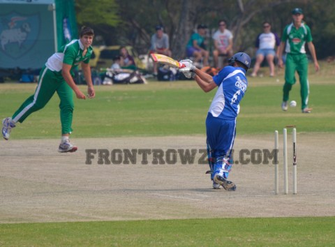 Eli Snyman of St John's bowls out Dean Peall of Peterhouse
