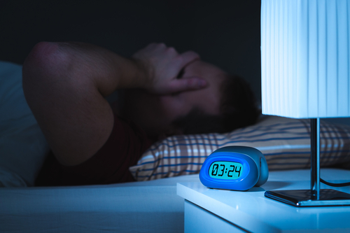 man with difficulty sleeping at 3am