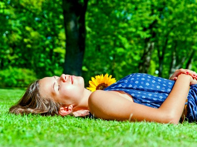 Young woman sleeping on the grass