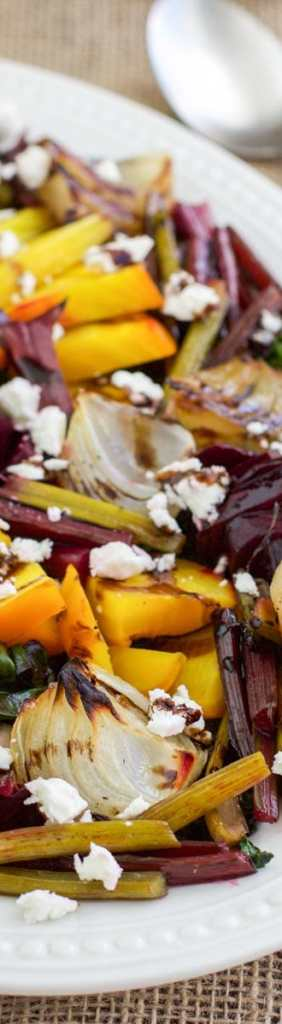 Sweet roasted beet and onion salad is the best side dish for summer! Topped with tangy feta cheese and a rich balsamic drizzle gives it loads of flavor! This salad uses all parts of the beet! Vegetarian.