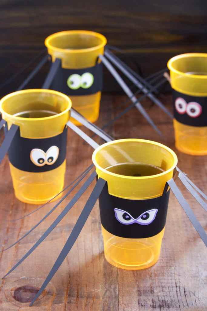 Creepy crawly DIY Halloween spider cups are perfect for a Halloween party or for a fun Halloween craft to make with the kids!