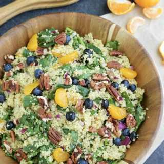 Summery quinoa spinach salad with sweet mandarin oranges, blueberries, red onions, toasted pecans, and tangy mango kiwi dressing will be your go-to healthy lunch. Vegan, dairy-free, gluten-free.