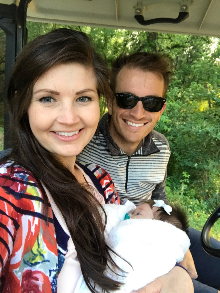 Family on a golf cart with young baby