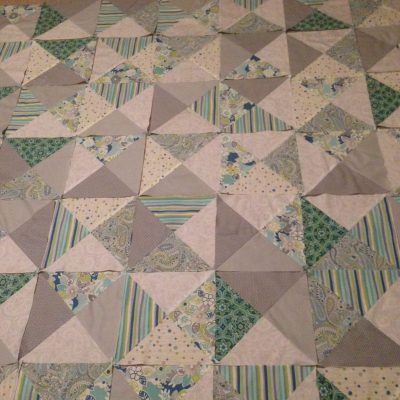 Lots of half square triangles. Blocks are arranged and ready to sew together.  - making progress here at Stacey Sansom Designs