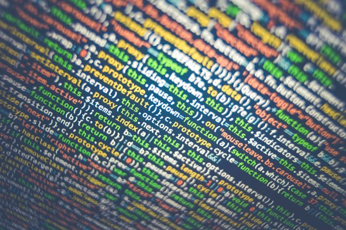 multicolored programming code fills the page at a slant.