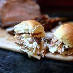 Smoky roasted pulled pork sliders with coleslaw made with mustard and apples