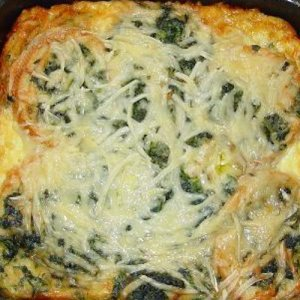 The top layer of a cheesy, delicious spinach strata.