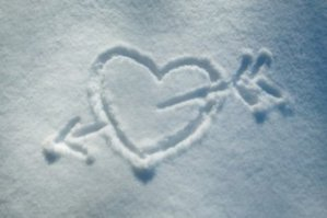 Drawing of heart and arrow in snow.