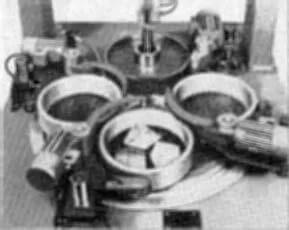Close-up view of FLM 750-P optical polishing machine