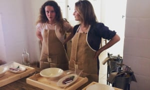 Harriet and her daughter with aprons on at the cookery school