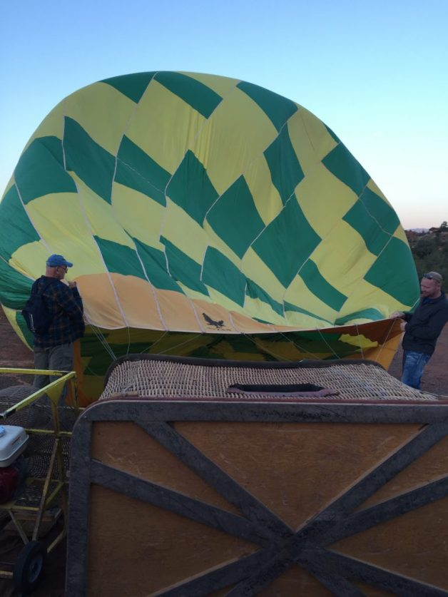 Husband is on the right helping get the balloon ready