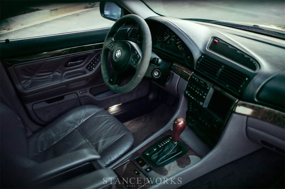 medium resolution of inside the car sports an oem lavendergrau purple interior with 750il leather trimmings and accessories as well as an e46 m3 alcantara sport steering