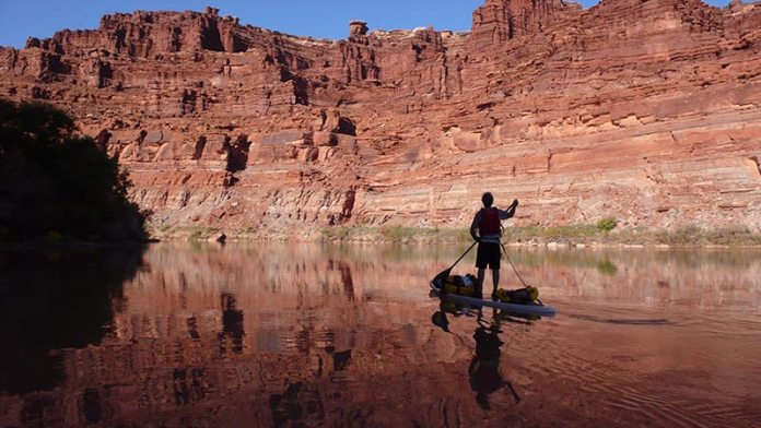John Scott Day 2 of our 54 mile paddle board trip down the Colorado River from Potash to the Confluence in October 2012. Picture is of John Scott taken by Richard Hoff. We believe we may have been the first to sup down the Colorado without a support boat. Incredible trip done by two good friends enjoying some of the best scenery in the world out our own backyard.