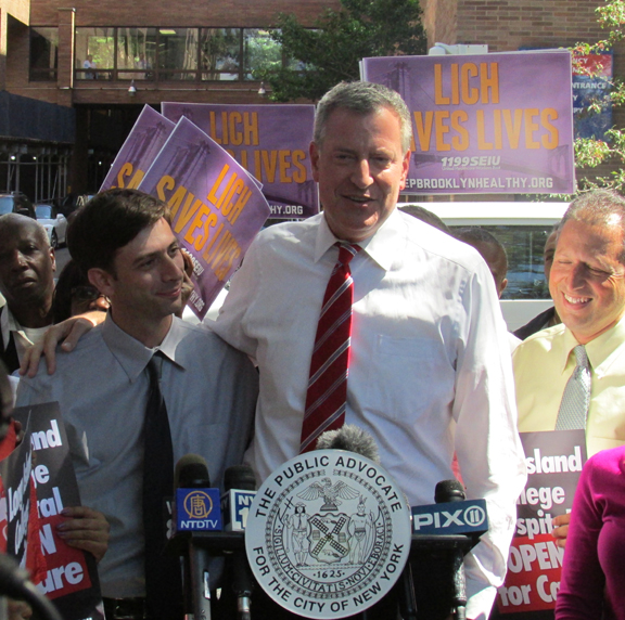 Bill embracing his local political friends from the City Council, Steve Levin and Brad Lander