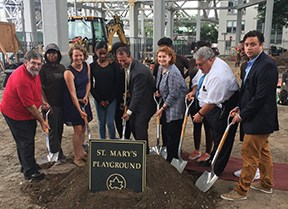 Mark Shames, Andrea Parker, Brad Lander, Jo Ann Simon, Mary Maher and Michael Racioppo pose for the ceremonial groundbreaking of the new St. Mary's Playground.