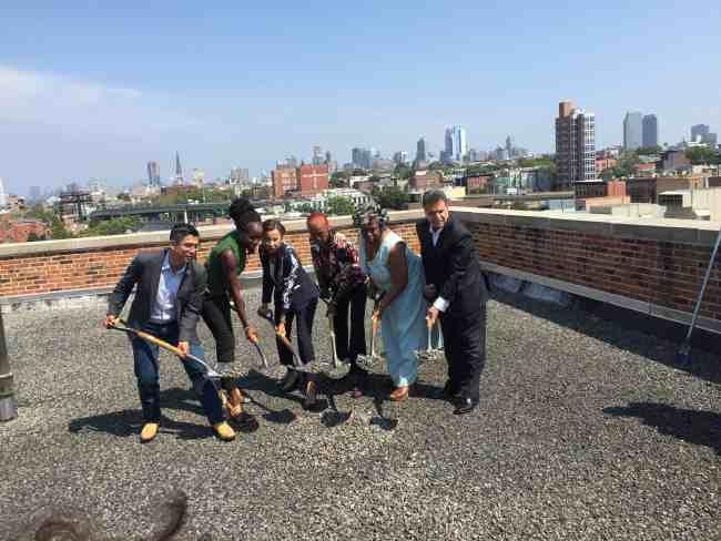 Carlos Menchaca, Shola Olatoye, Nydia Velazquez, Lily Marshall, Frances Brown and Felix Ortiz on the roof of 791 Hicks Street.