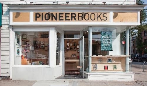 Pioneer Books is located at 289 Van Brunt Street.