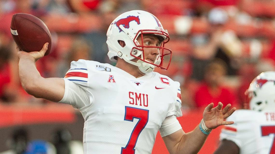 SMU quarterback Shane Buechele drops back for a pass attempt during the first half against Arkansas State in an NCAA college football game Saturday, Aug. 31, 2019, in Jonesboro, Ark. (Quentin Winstine/The Jonesboro Sun via AP)