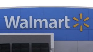 ASSOCIATED PRESS A Walmart logo was displayed, Sept. 3, outside of a Walmart store, in Walpole, Mass. Walmart said it will stop selling electronic cigarettes at its namesake stores and Sam's Clubs following a string of illnesses and deaths related to vaping.