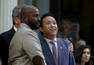 ASSOCIATED PRESS                                 Assemblyman David Chiu, D-San Francisco, right, flanked by assemblyman Mike Gipson, D-Carson, smiled, Sept. 11, as his measure to cap rent increases was approved by the Assembly in Sacramento, Calif. Gov. Gavin Newsom is expected to sign the bill today.