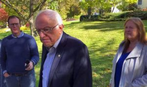 ASSOCIATED PRESS                                 In this image taken from video, Democratic presidential candidate Sen. Bernie Sanders, I-Vt., speaks we reporters outside his home today in Burlington, Vt. His wife, Jane O'Meara Sanders listens at right.