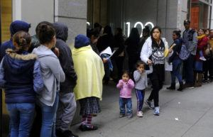 ASSOCIATED PRESS                                 In this Jan. 31, 2019 photo, hundreds of people overflow onto the sidewalk in a line snaking around the block outside a U.S. immigration office with numerous courtrooms in San Francisco.