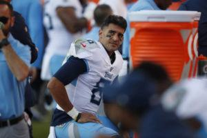 ASSOCIATED PRESS                                 Tennessee Titans quarterback Marcus Mariota looks on from the sideline during the second half of an NFL football game against the Denver Broncos, Sunday in Denver.