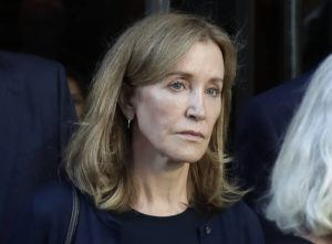 ASSOCIATED PRESS / Sept. 13                                 Actress Felicity Huffman leaves federal court after her sentencing in a nationwide college admissions bribery scandal in Boston on Sept. 13. A representative for Huffman says she reported to a federal prison in California to serve a two-week sentence today.