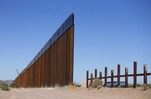 ARIZONA DAILY STAR VIA AP The new 30-foot tall bollard fence that replaced old U.S.-Mexico border fence can be seen on the left. It's located near the Lukeville, Ariz., port of entry.