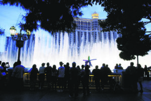 ASSOCIATED PRESS / 2004                                 People line the edge of the lake at the Bellagio in Las Vegas, after the hotel opened at 5 p.m.