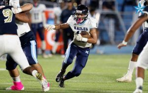 BY ANDREW LEE / SPECIAL TO THE STAR-ADVERTISER Kailua's Brian-Allen Kamanu rushes with the ball during Saturday's game at Waipahu.