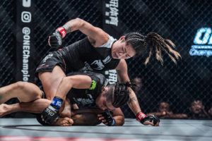 COURTESY ONE CHAMPIONSHIP Angela Lee gets on top of Xiong Jing Nan during their bout in Tokyo.