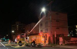 COURTESY RACHEL BRADLEY                                 Honolulu firefighters battle a building fire Friday night on Kapiolani Boulevard. No one was hurt, but a squatter was found inside the abandoned building.
