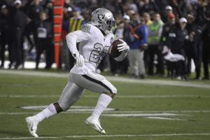 ASSOCIATED PRESS                                 Oakland Raiders running back Josh Jacobs ran on the way to a touchdown against the Los Angeles Chargers during the second half of a game in Oakland, Calif., Thursday.