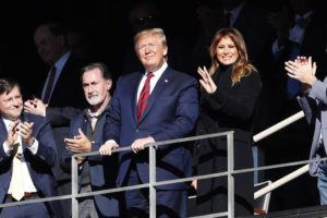 ASSOCIATED PRESS                                 President Donald Trump watches the first half of an NCAA football game between Alabama and LSU with his wife, Melania.