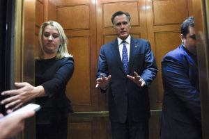 ASSOCIATED PRESS                                 Sen. Mitt Romney, R-Utah, gets in an elevator as he is followed by reporters on Capitol Hill in Washington on Tuesday.